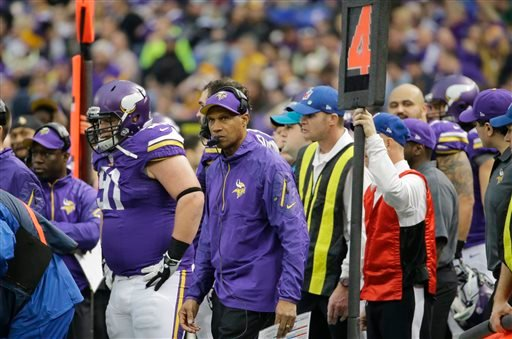 Minnesota Vikings head coach Leslie Frazier, center, watches from the sidelines during the second half of an NFL football game against the Detroit Lions, Sunday, Dec. 29, 2013, in Minneapolis. The Vikings won 14-13. (AP Photo/Ann Heisenfelt)