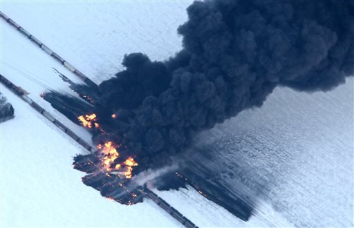 A fire from a train derailment burns uncontrollably as seen in this aerial photograph Monday, Dec. 30, 2013, west of Casselton, N.D. (AP Photo/The Forum, Michael Vosburg)