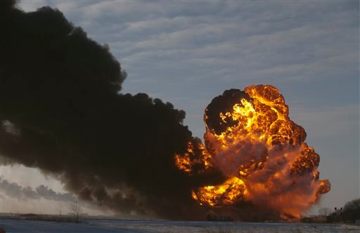 A fireball goes up at the site of an oil train derailment Monday, Dec 30, 2013, in Casselton, N.D. Several explosions were reported as some cars on the mile-long train caught fire. (AP Photo/Bruce Crummy)