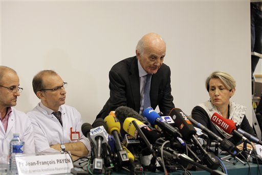Professor Gerard Saillant, center, answers journalists questions during a press conference at the Grenoble hospital, in the French Alps, where former seven-time Formula One champion Michael Schumacher is being treated.(AP Photo/Laurent Cipriani)
