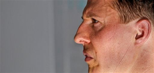 In this March 12, 2010 file photo Mercedes Grand Prix driver Michael Schumacher of Germany is pictured in the garage after finishing the second practice session at the Formula One Bahrain.(AP Photo/Ben Curtis, File)