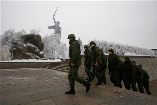 Russian soldiers patrol the Battle of Stalingrad memorial in Volgograd, Russia, Tuesday, Dec. 31, 2013.(AP Photo/Denis Tyrin)