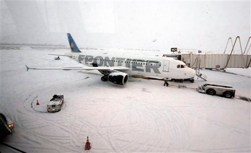 A Frontier airplane waits for passengers at O'Hare International Airport in Chicago, Thursday, Jan. 2, 2014.(AP Photo/Nam Y. Huh)