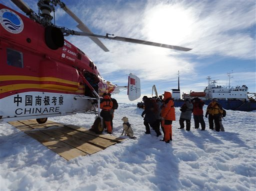 In this photo provided China's official Xinhnua News Agency, passengers from the trapped Russian vessel MV Akademik Shokalskiy, seen at right, prepare to board the Chinese helicopter Xueying 12 in the Antarctic Thursday, Jan. 2, 2014. (AP)
