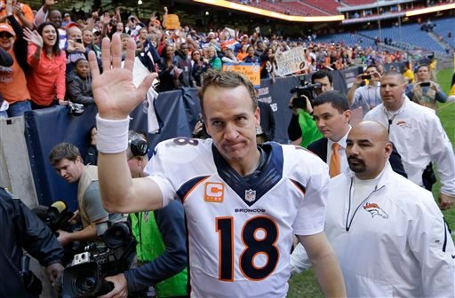 In this Dec. 22, 2013 file photo, Denver Broncos' Peyton Manning (18) waves to fans following an NFL football game against the Houston Texans in Houston. (AP Photo/David J. Phillip)