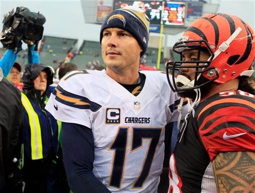 San Diego Chargers quarterback Philip Rivers (17) shakes hands with Cincinnati Bengals linebacker Rey Maualuga after a 27-10 win over the Bengals in an NFL wild-card playoff football game on Sunday, Jan. 5, 2014, in Cincinnati. (AP Photo/Tom Uhlman)