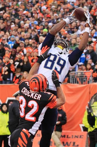 San Diego Chargers tight end Ladarius Green (89) catches a 4-yard touchdown pass against Cincinnati Bengals safety Chris Crocker (32) in the second half of an NFL wild-card playoff football game on Sunday, Jan. 5, 2014, in Cincinnati.