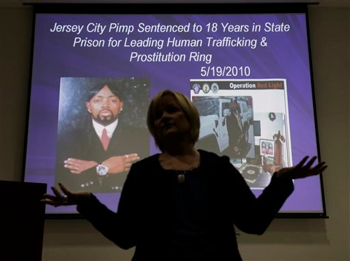In this Thursday, Dec. 19, 2013 photograph, Kathleen Friess gives a presentation on human trafficking in Hamilton Township, N.J., for hotel and nightclub employees and tries to dispel notions of what human trafficking looks like.