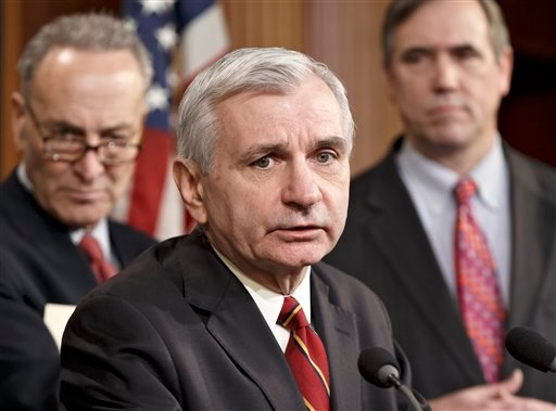 Sen. Jack Reed, D-R.I., center, joined by Sen. Charles Schumer, D-N.Y., left, and Sen. Jeff Merkley, D-Ore., right, meets with reporters on Capitol Hill in Washington, Tuesday, Jan. 7, 2014.