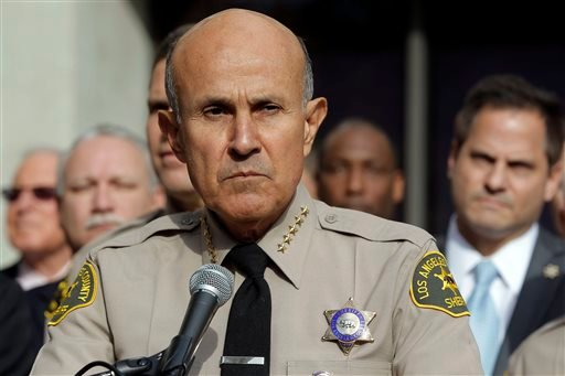 Los Angeles County Sheriff Lee Baca announces his retirement at a news conference at Sheriff's Headquarters Bureau in Monterey Park, Calif., Tuesday, Jan. 7, 2014. (AP)