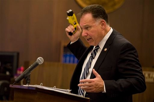 Orange County DA Tony Rackauckas uses a taser similar to the one used by officer Jay Cicinelli as a blunt-force weapon against Kelly Thomas during closing arguments Jan. 7, 2014 in Santa Ana. (AP Photo/The Orange County Register, Joshua Sudock, Pool)