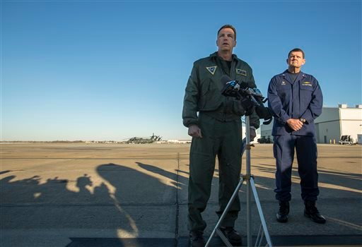 Navy Cmdr. Todd Flannery, left, Cmdr. Helicopter Sea Combat Wing Atlantic, and U.S. Coast Guard Capt. John K. Little, Sector Commander, as they answer questions about a crash of a Navy MH-53-E Sea Dragon helicopter into the Atlantic off Virginia Beach.
