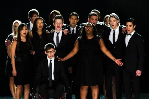 This photo released by Fox shows the McKinley family of the past and present joining together to remember and celebrate the life of Finn Hudson.(AP Photo/Fox, Adam Rose)
