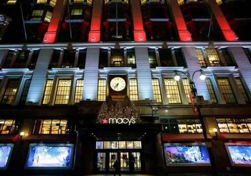 FILE - In this Tuesday, Dec. 17, 2013, file photo, Macy's department store in Herald Square is illuminated with holiday lighting, in New York. Macy's said Wednesday, Jan. 8, 2014, it is laying off 2,500 workers as it restructures business. (AP Photo)