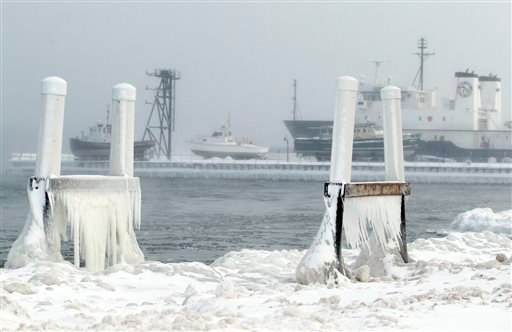 FILE - In this Jan. 7, 2014 photo ice forms on parts of a dock on West Grand Traverse Bay near the Great Lakes Maritime Academy in Traverse City, Mich. (AP)