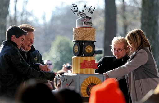 Canadian singer David Thibault, from left, TVand radio personality Wink Martindale, Knox Phillips and Jenna Bush Hager cut a cake to honor the birthday of the late Elvis Presley at Graceland in Memphis, Tenn. (AP)