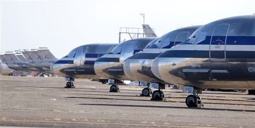 In this photo made Wednesday, Dec. 11, 2013, retired airliners sit parked at the airport in Roswell, New Mexico. (AP Photo/LM Otero)