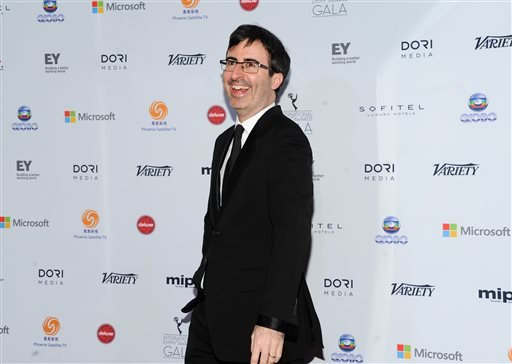 In this Nov. 25, 2013 file photo, Host John Oliver arrives at the 2013 International Emmy Awards Gala at the New York Hilton, in New York. Oliver spoke to a meeting of the Television Critics Association about his upcoming HBO comedy series.