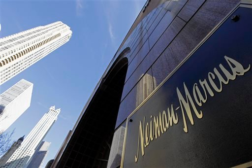 In this Wednesday, March 11, 2009 file photo, the Chicago skyline is reflected in the exterior of Neiman Marcus on Michigan Avenue in Chicago.