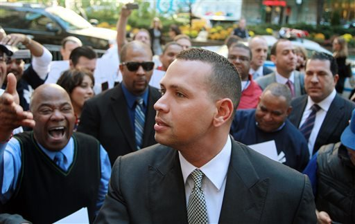In this Oct. 1, 2013, file photo, New York Yankees' Alex Rodriguez arrives at the offices of Major League Baseball in New York.