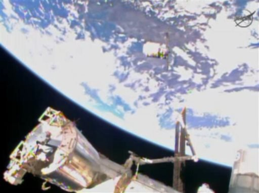 In this image from video provided by NASA the Cygnus resupply spacecraft approaches the International Space Station early Sunday Jan. 12, 2013.