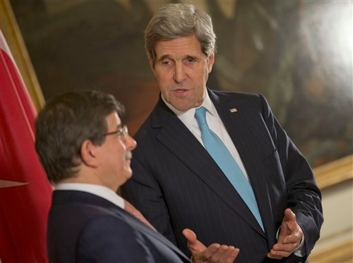 US Secretary of State John Kerry, right, speaks with Turkish Foreign Minister Ahmet Davutoglu, left, at the US Ambassador residence in Paris, France, Sunday, Jan. 12, 2014.
