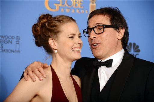 "Amy Adams, left, and David O. Russell, winners of the award for best motion picture - comedy or musical for ""American Hustle"" pose in the press room at the 71st annual Golden Globe Awards at the Beverly Hilton Hotel on Sunday, Jan. 12, 2014.."
