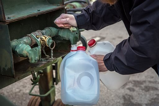 Local residents brought empty containers and coolers to distribution centers across Kanawha County (W.Va.) Sunday morning, Jan. 12, 2014 to fill with water after a chemical spill Thursday in the Elk River..