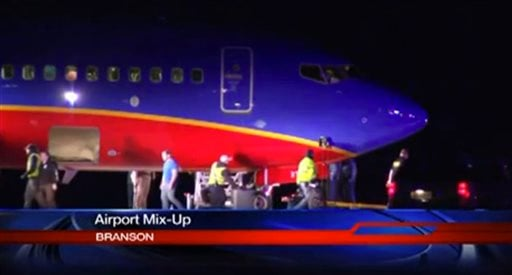 This frame grab provided by KSPR-TV shows a Southwest Airlines flight that was scheduled to arrive Sunday Jan. 12, 2014. (AP Photo/KSPR-TV)