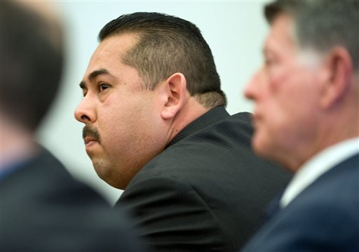 Former Fullerton police Officer Manuel Ramos reacts after being acquitted Monday Jan. 13, 2014, in Santa Ana, Calif., of second-degree murder and involuntary manslaughter charges stemming from the 2011 death of transient Kelly Thomas.
