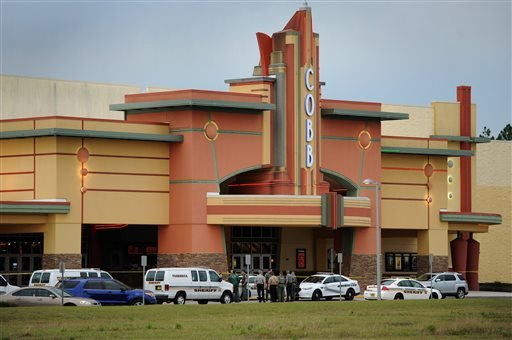 Authorities stand outside Cobb theater after a shooting in Wesley Chapel, Fla., Monday, Jan. 13, 2014.