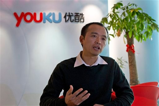 In this Thursday, Dec. 12, 2013 photo, Zhu Huilong, senior vice president of Youku Tudou, answers questions during an interview at the Youku headquarters in Beijing, China.