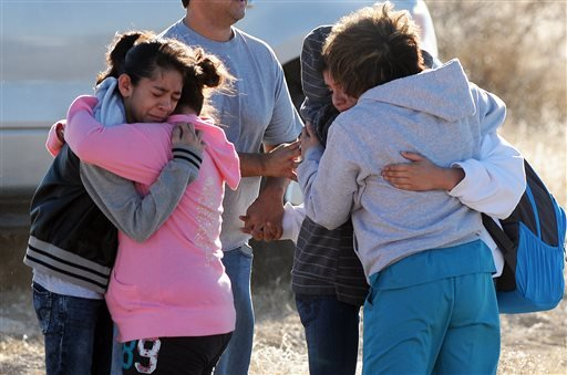 Students are reunited with family following a shooting at Berrendo Middle School, Tuesday, Jan. 14, 2014, in Roswell, N.M.
