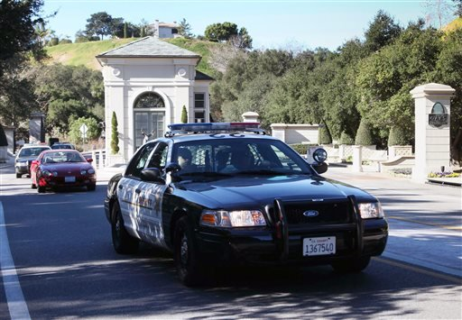 """Los Angeles County Sheriff's leave """"The Oaks of Calabasas"""" property, where the residence of the pop star, Justin Bieber was searched by police in Calabasas, Calif., on Tuesday, Jan 14, 2014. (AP)"""