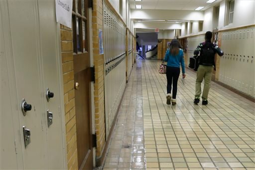 FILE - In this Monday, Jan. 13, 2014, file photo, two students walk in a hallway at Little Rock Central High School in Little Rock, Ark. (AP)