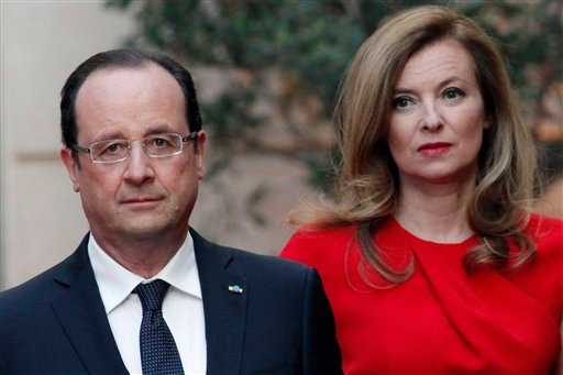 French President Francois Hollande leaves after his annual news conference, Tuesday, Jan.14, 2014 at the Elysee Palace in Paris. (AP)