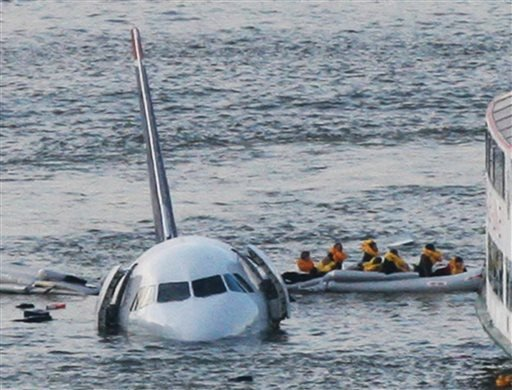 FILE - In this Jan. 15, 2009 file photo, passengers in an inflatable raft move away from US Airways Flight 1549 that went down in the Hudson River in New York. (AP)