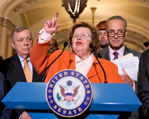 FILE - This Aug. 1, 2013 file photo shows Senate Appropriations Committee Chair Sen. Barbara Mikulski, D-Md., flanked by Senate Majority Whip Richard Durbin of Ill., left, and Sen. Charles Schumer, D-N.Y., speaking on Capitol Hill in Washington. (AP)