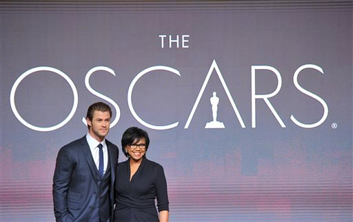 Chris Hemsworth, left, and President of the Academy Cheryl Boone Isaacs pose at the 86th Academy Awards nomination ceremony on Thursday, Jan. 16, 2013 in Beverly Hills, Calif. (AP)