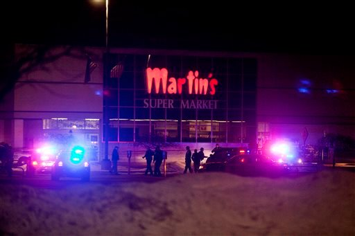 Elkhart Police, the Elkhart Fire Department, Indiana State Police and emergency personnel respond to reports of a shooting inside Martin's Supermarket in Elkhart, Ind., about 10:30 p.m. Wednesday, Jan. 15, 2014. (AP)