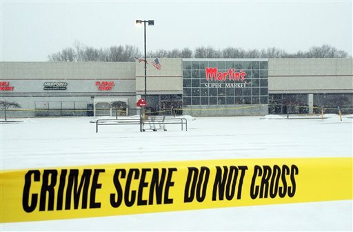 Police tape marks off the parking lot at the Martin's Supermarket in Elkhart Ind., Thursday, Jan 16, 2014. (AP)