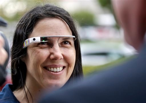 Cecilia Abadie wears her Google Glass as she talks with her attorney outside of traffic court in this Dec. 3, 2013 file photo taken in San Diego. (AP Photo/Lenny Ignelzi, File)