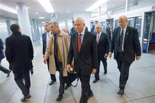 Republican lawmakers arrive at the Capitol as the Senate votes to approve a $1.1 trillion spending package, the Omnibus Appropriations Act, a bipartisan compromise that all but banishes the likelihood of an election-year government shutdown. (AP)