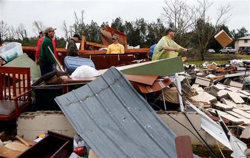 In this April 11, 2013 file photo, Shuqualak, Miss. residents begin cleanup of debris from homes after a tornado plowed through rural sections of eastern Mississippi, killing at least one person and causing widespread damage and power outages.