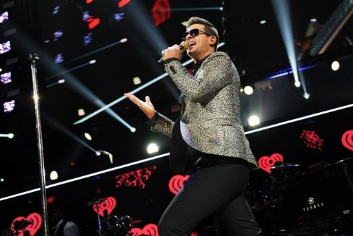 This Dec. 13, 2013 file photo shows Robin Thicke performing at Z100's Jingle Ball 2013 at Madison Square Garden in New York.
