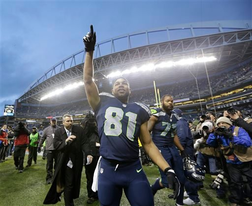 Seattle Seahawks wide receiver Golden Tate celebrates after an NFC divisional playoff NFL football game against the New Orleans Saints in Seattle, Saturday, Jan. 11, 2014. The Seahawks won 23-15. (AP Photo/Elaine Thompson)