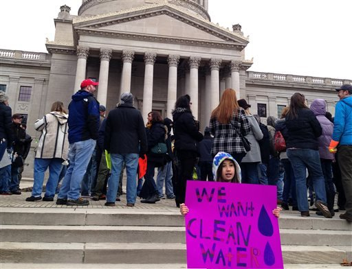 Emma Del Torto of Charleston, W.Va. holds a sign during a demonstration at the state Capitol on Saturday, Jan.18, 2014. More than 100 people gathered to question their tap water's quality following a chemical spill that tainted the local water supply.