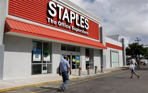 This March 6, 2013 file photo shows a Staples office supply store Miami. The opening of Postal Service retail centers in dozens of Staples stores around the country is being met with threats of protests and boycotts by the agency's unions.