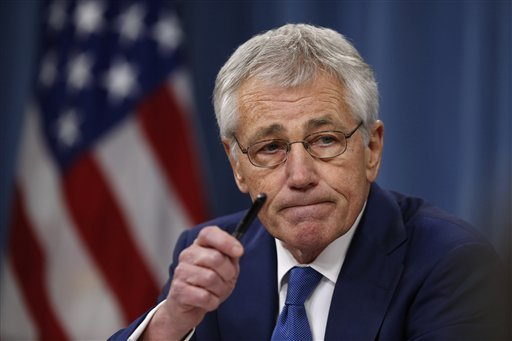In this Dec. 19, 2013 file photo, Defense Secretary Chuck Hagel takes questions as he briefs reporters at the Pentagon in Washington.