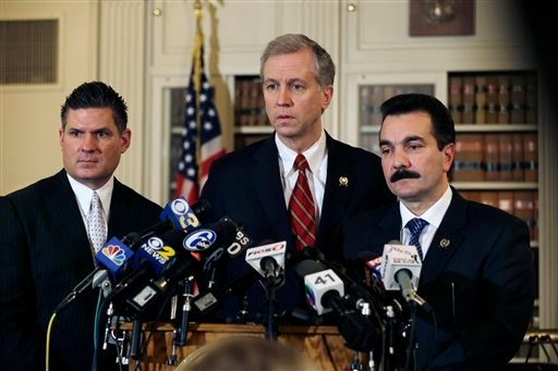 New Jersey Assemblymen John S. Wisniewski, center, D-Sayreville, N.J., Lou D. Greenwald, left, D-Vorhees, N.J., and incoming Assembly Speaker Vincent Prieto, D-Secaucus, N.J., address the media Monday, Jan. 13, 2014, in Trenton, N.J.